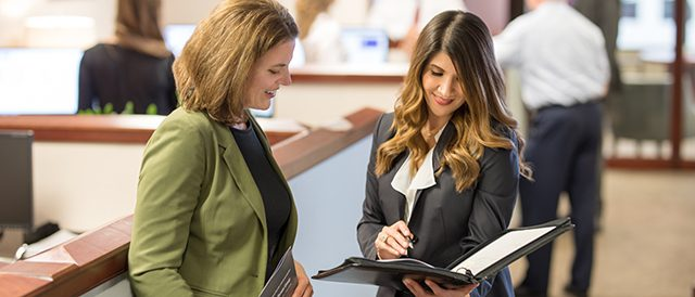 Broadridge_Action 640x274_Deanna and Tracy looking at papers_4482.jpg